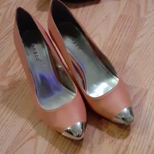 Pink heels with metallic silver toe